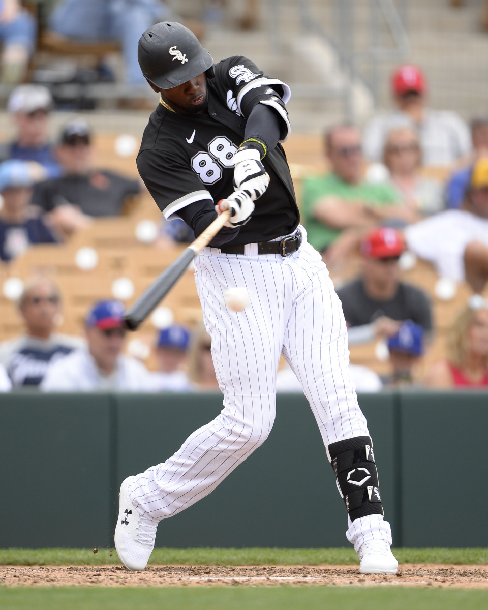 Luis Robert of the Chicago White Sox bats against the Rangers during spring training. Photo: Ron Vesely/Getty Images