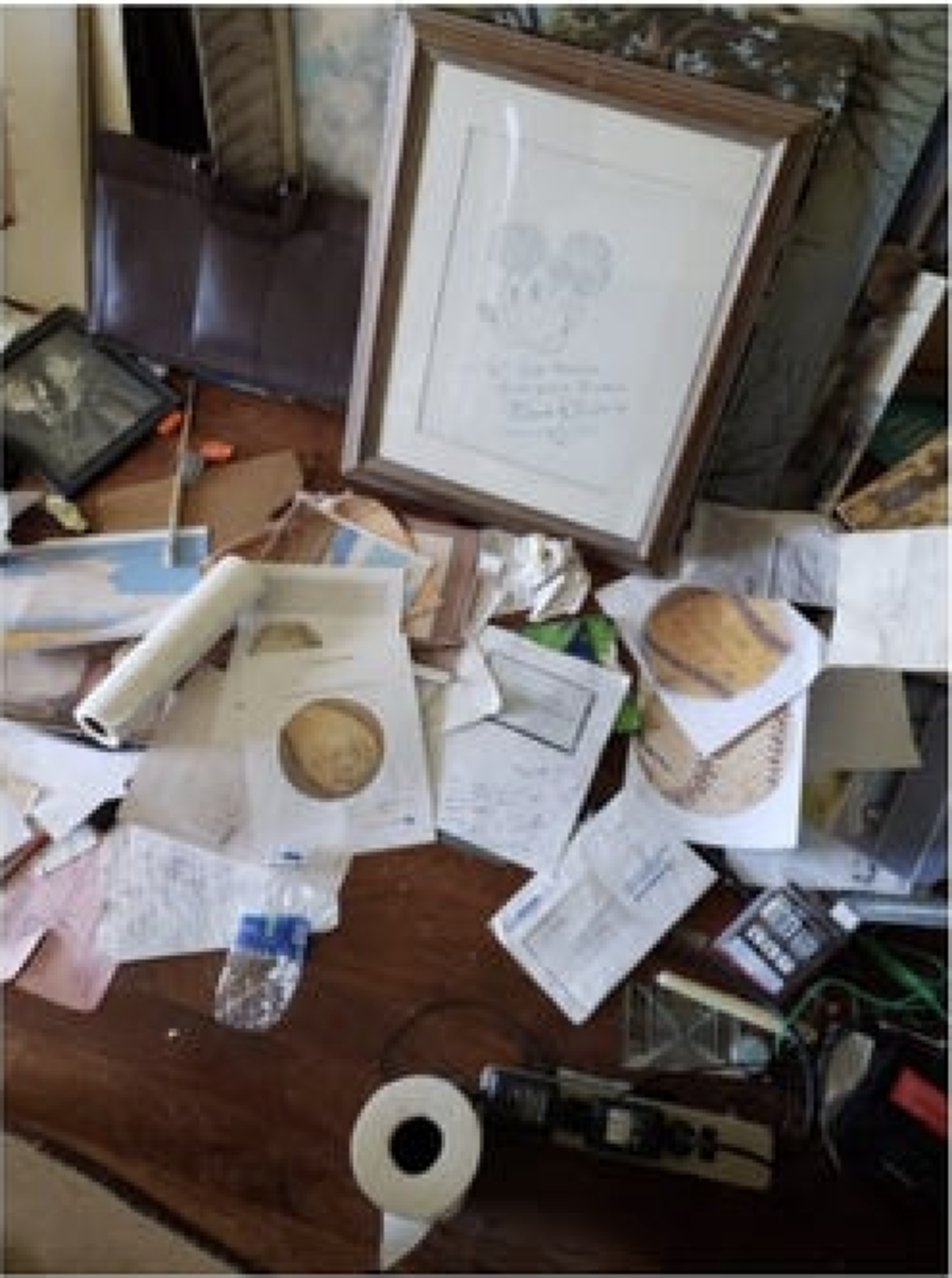 Sports memorabilia and tools to make them were discovered during the raid, as was a Mickey Mouse drawing autographed by Walt Disney. Photo courtesy of the FBI.