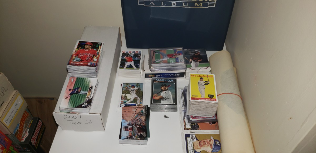 Collectors like Thomas Miller sort through card stacks to formulate trades.