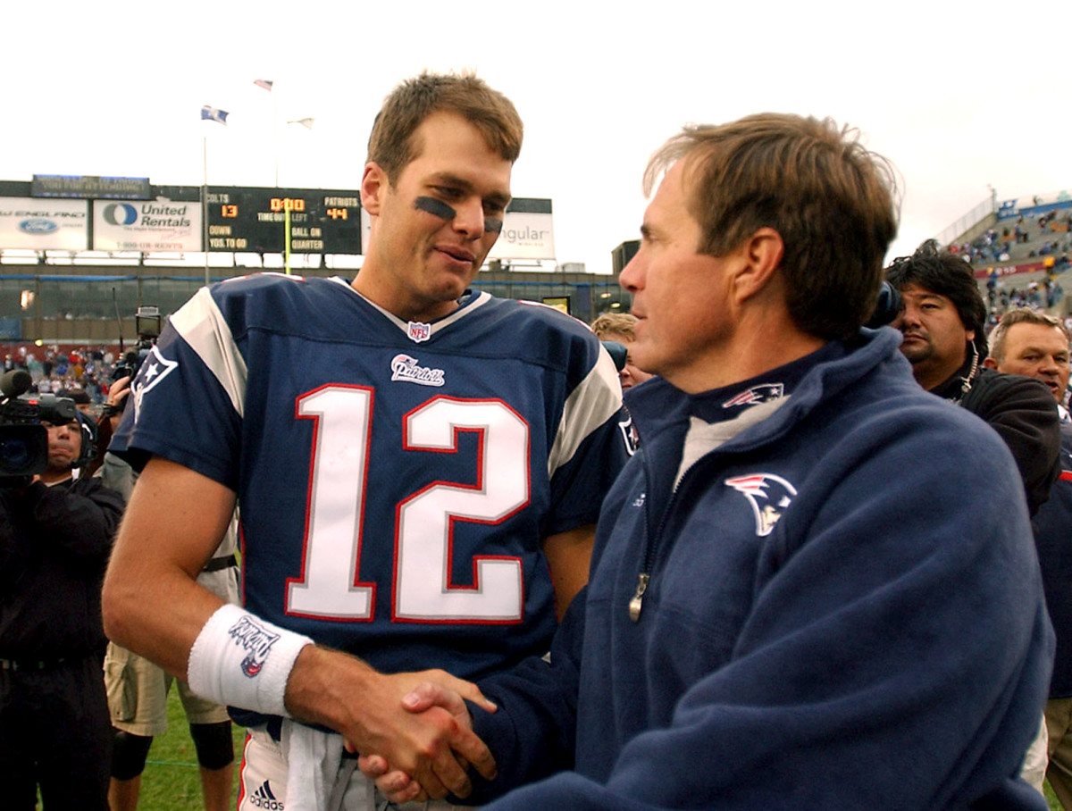 Tom Brady is congratulated by Patriots head coach Bill Belichick after one of his first wins in October 2001.