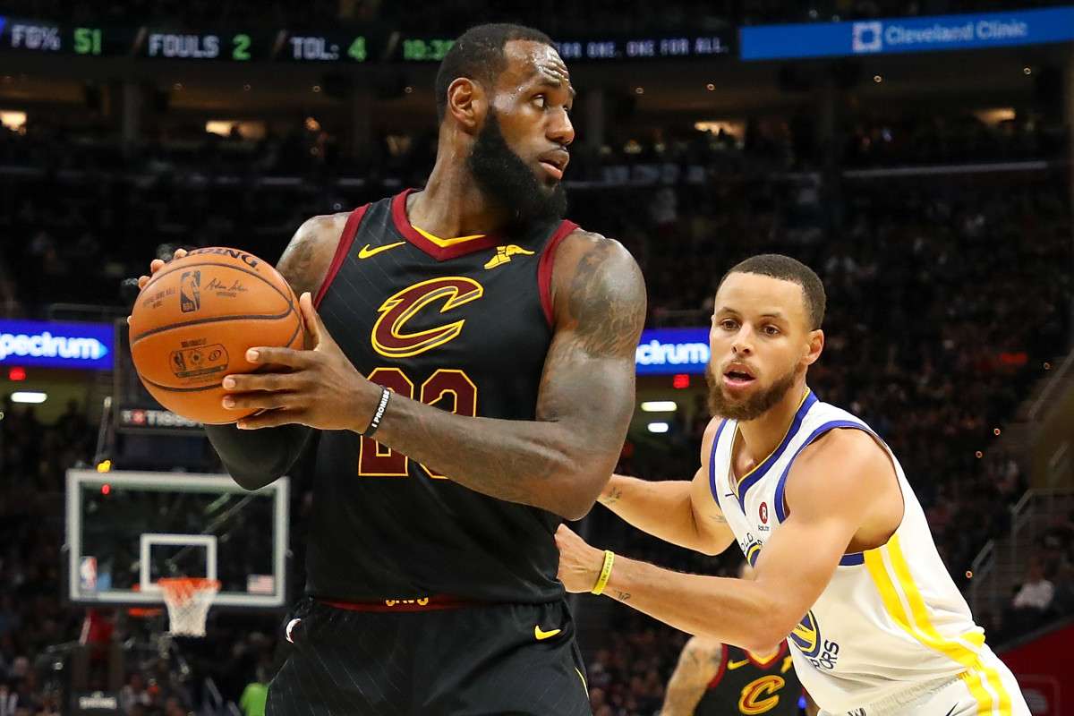 LeBron James works against Steph Curry during the 2018 NBA Finals.