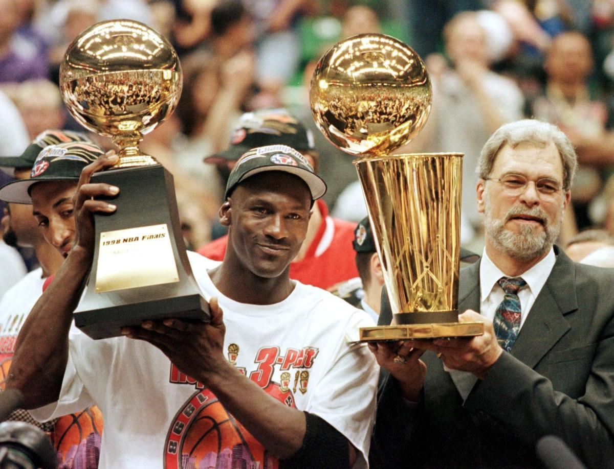 Michael Jordan and head coach Phil Jackson after winning their sixth NBA championship in 1998.