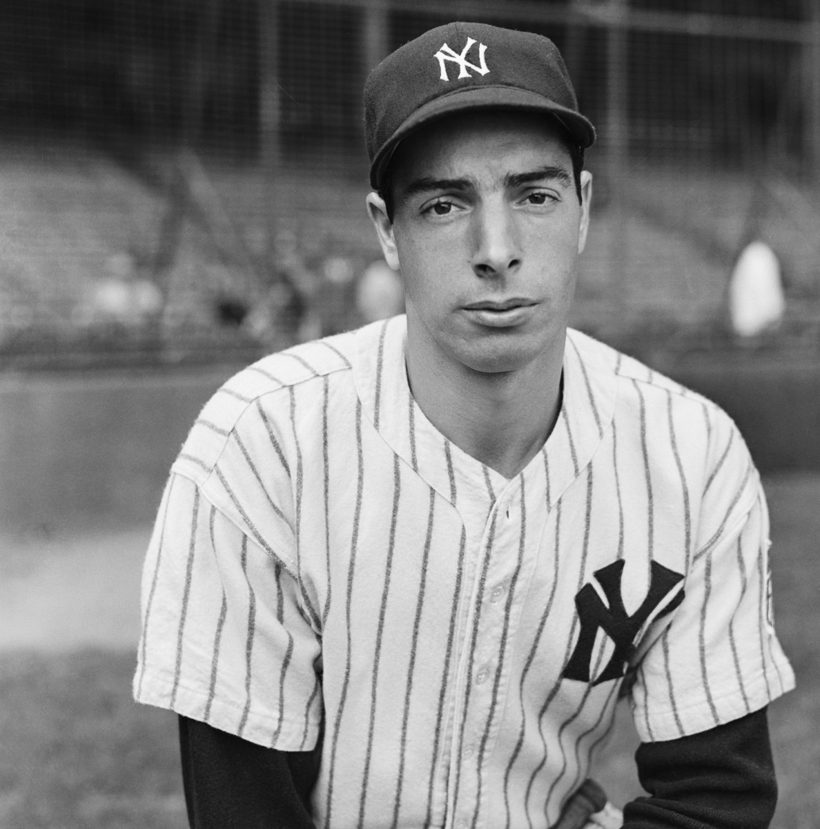 """Joe DiMaggio after the Yankees clinched the 1942 American League pennant. Early in his career, DiMaggio was known as """"Dead-Pan Joe."""""""