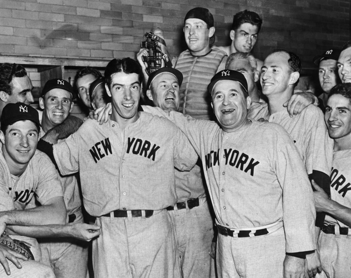Manager Joe McCarthy and the 1941 Yankees celebrate Joe DiMaggio's record hitting streak.