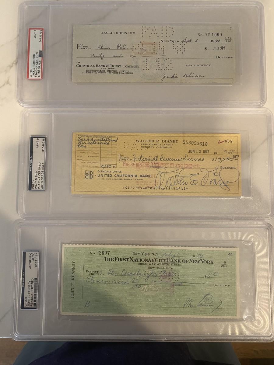 Checks signed by Jackie Robinson, Walt Disney and John F. Kennedy.