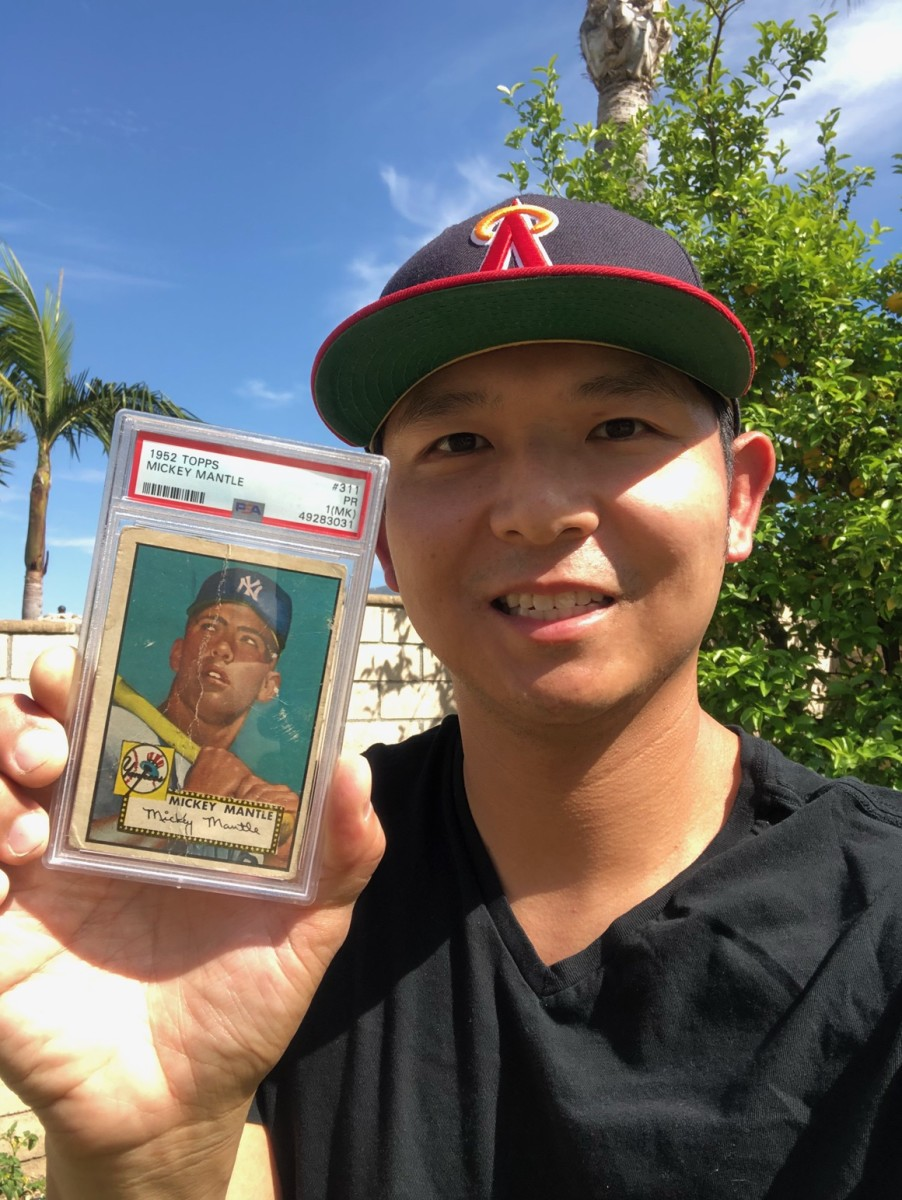 Bryan Eugene with a 1952 Mickey Mantle rookie card that was found in a Mennonite barn in Canada.