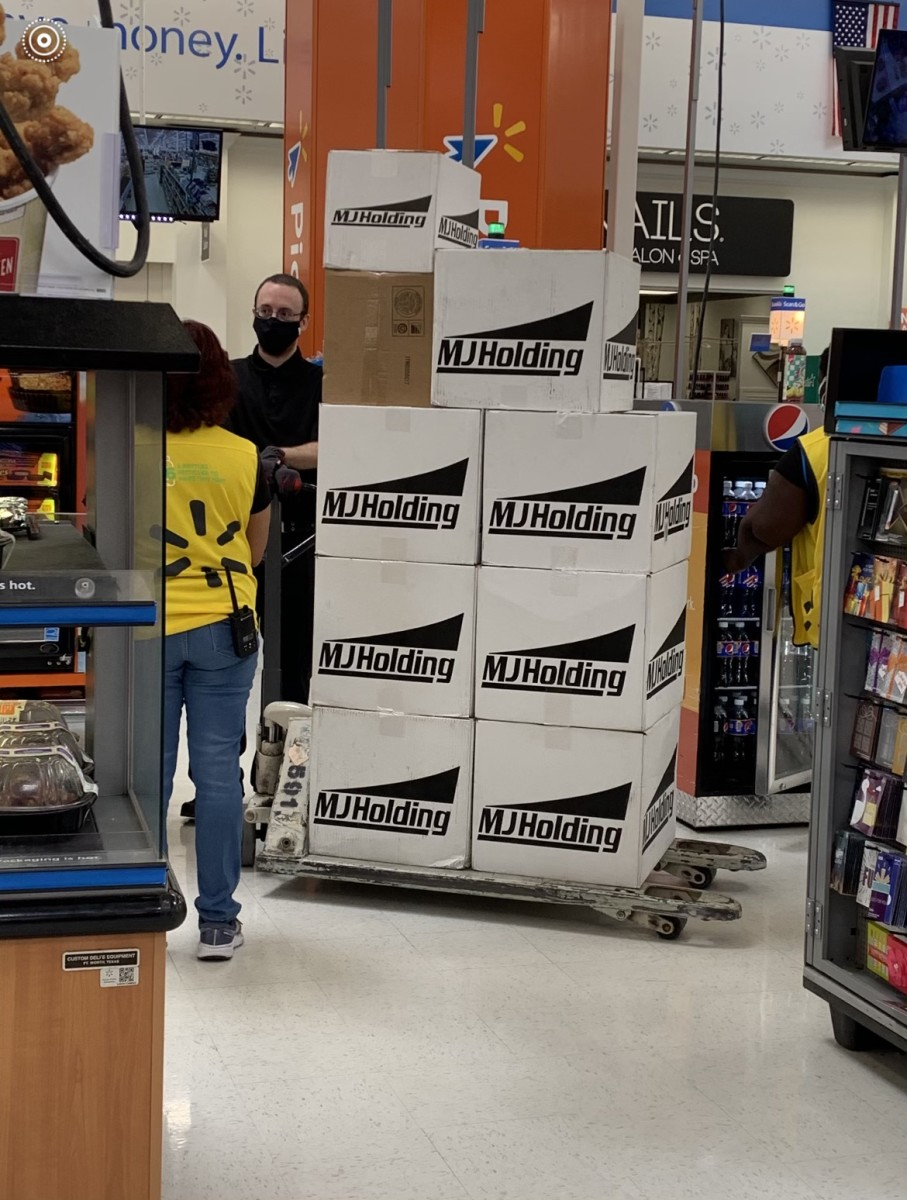 Employees at Walmart in Miramar, Fla. prepare to stock the shelves with boxes of trading cards.