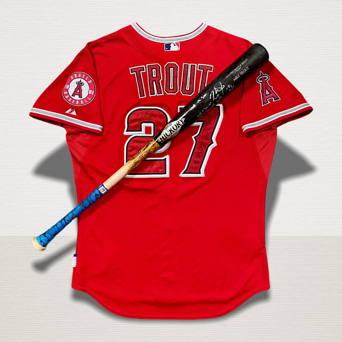 Mike Trout game-used jersey and bat.