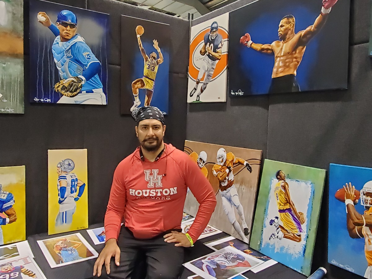 Artist Isaac Rodriguez shows off his work.