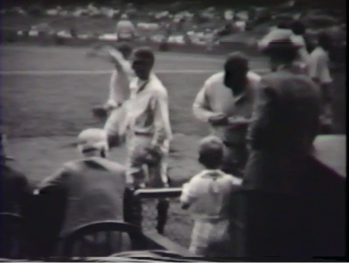 Screenshot from video of Babe Ruth signing a baseball for James Tonking III in 1929.