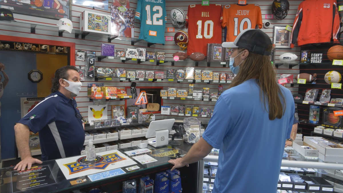 The Card Life host Matt Strahm visits AZ Sports Cards owner John Gola during the filming of an episode in Phoenix.