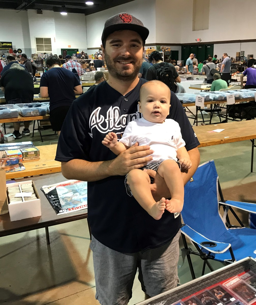 Dealer Jon Robinson and his son, James, at the Sports Card Show in Raleigh, N.C.