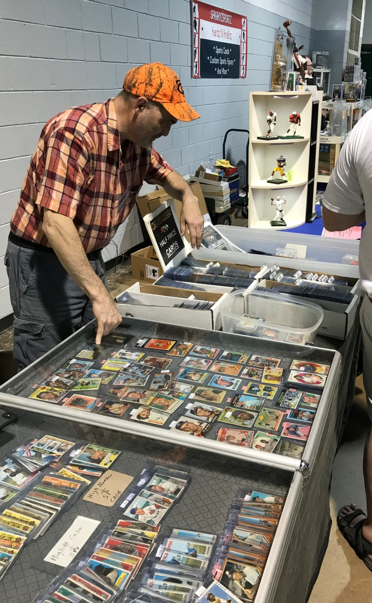 Kurt Tourdot with his vintage cards at the Sports Card Show in Raleigh, N.C.