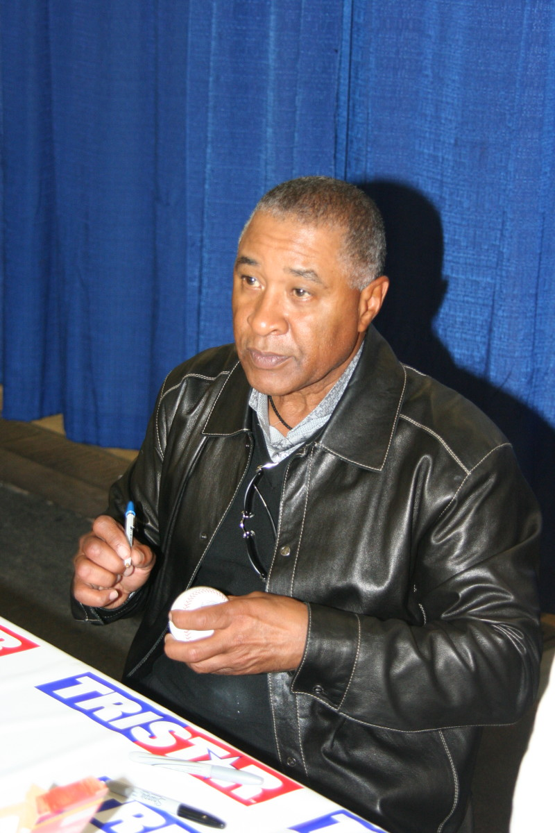 Hall of Famer Ozzie Smith signs autographs during the 2019 National.