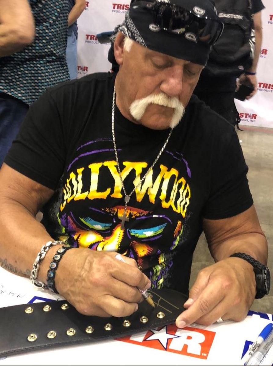 WWE star Hulk Hogan signs autographs during the 2019 National.