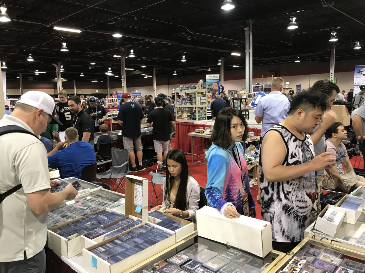A collector checks out a bargain bin at the 2019 National.