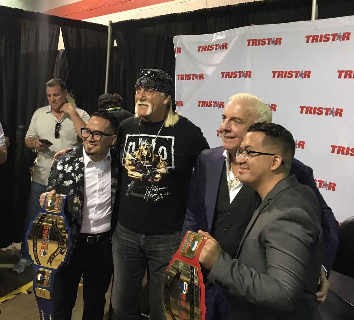Hulk Hogan and Ric Flair pose for photos with fans.