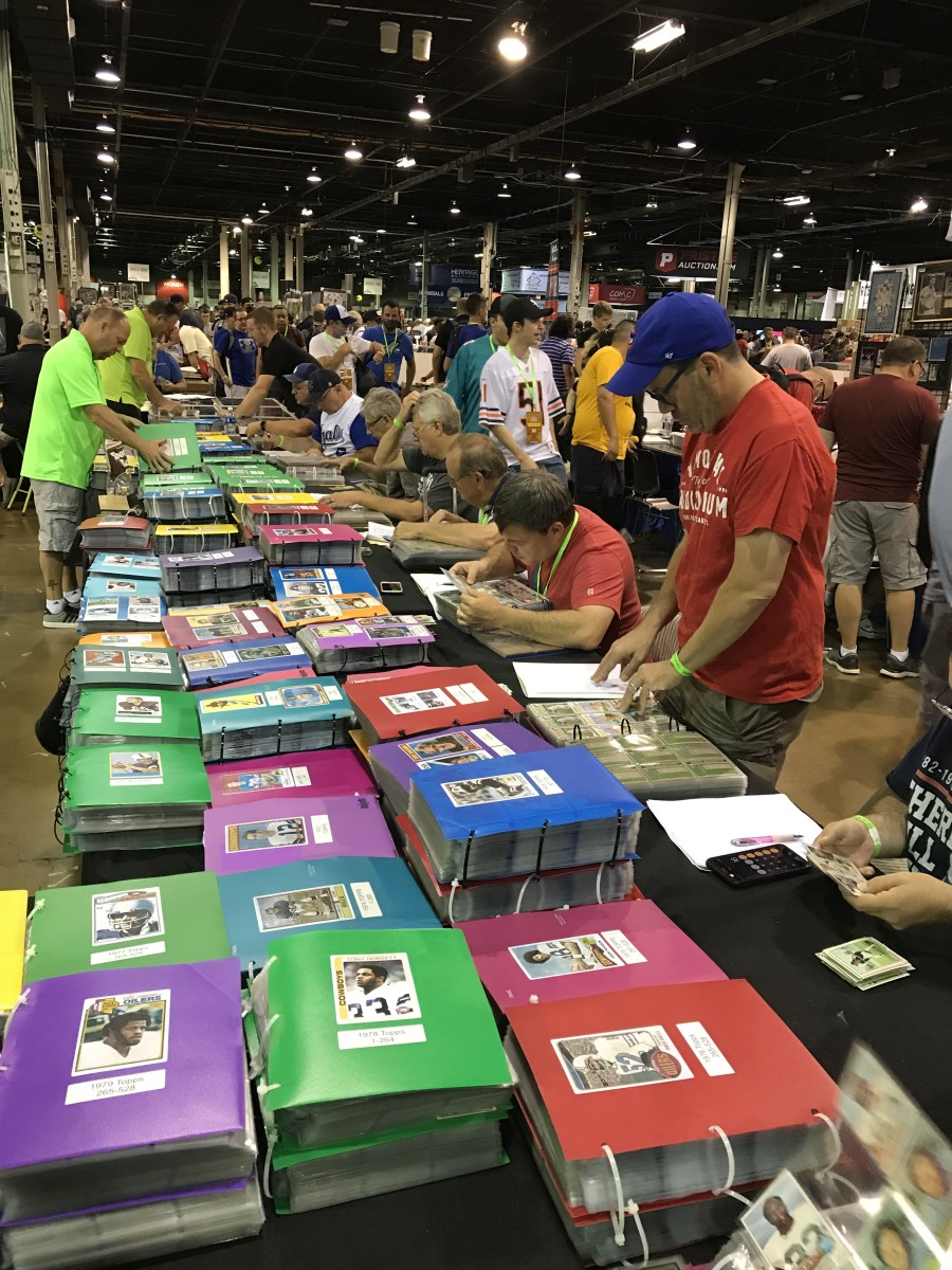 Collectors look through vintage cards at the Uncle Dick's Cards booth at The National.