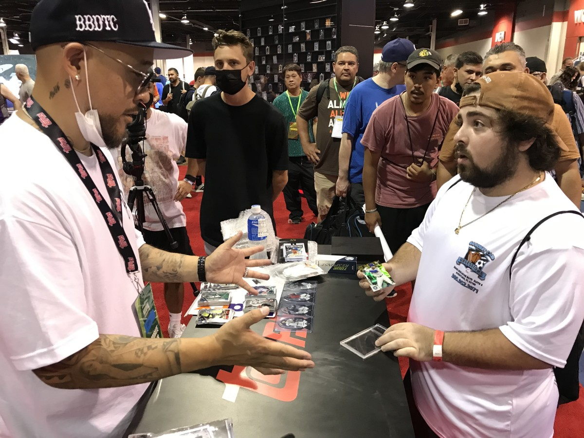 Topps Project 70 artist Ben Baller chats with a collector of his baseball art cards.