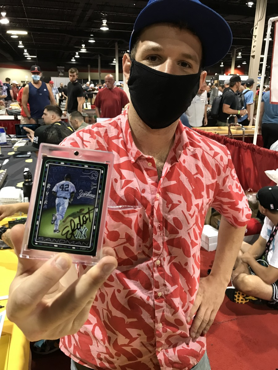 Topps Project 70 artist Efdot shows off one of his cards.