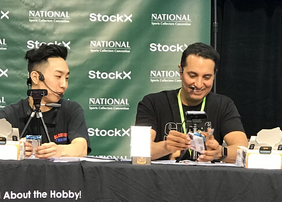 ESPN Sports Center anchor Kevin Negandhi opens a pack of cards during a break on the main stage at The National.