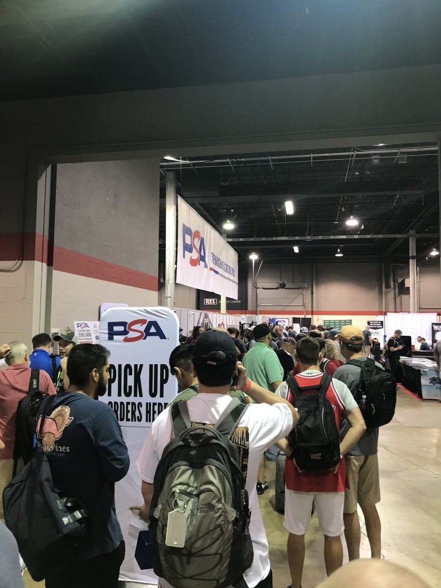 Collectors stand in line to pick up cards they submitted to PSA at The National.