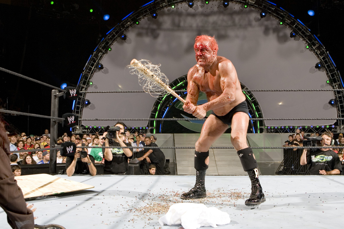 Ric Flair with his barb wire bat being auctioned by Goldin Auctions.