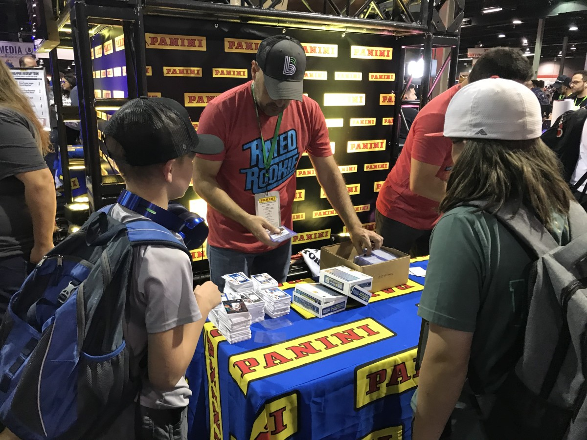Young card collectors visit the Panini booth at the National Sports Collectors Convention.