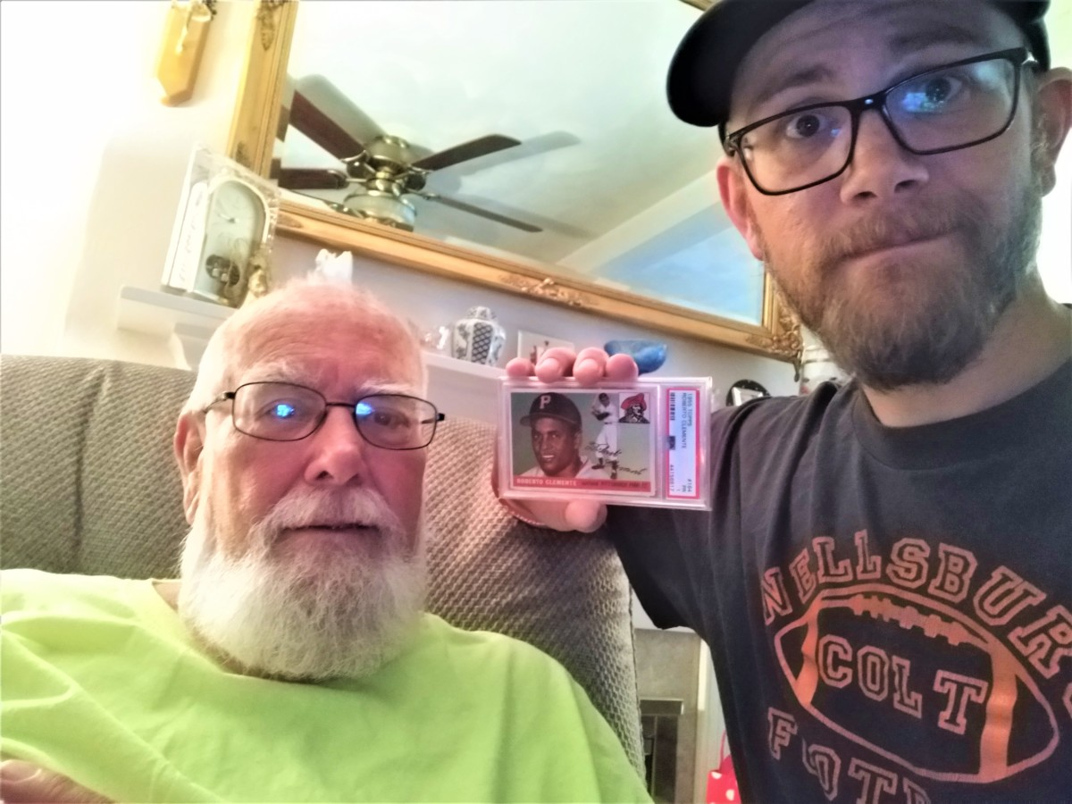 Topps collector Bob Lewis with his dad and his Roberto Clemente card.